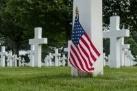 american-flag-and-crossed-at-cemetery-royalty-free-image-763277505-1556299462.jpg