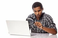 man-at-computer-with-magnifying-glass-shutterstock-510px.jpg